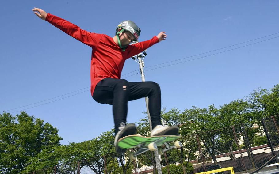 Ben Wellons, 13, performs a trick at a renovated skate park at Yokota Air Base, Japan, Friday, April 30, 2021.