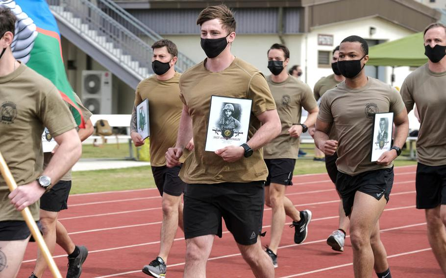 Special warfare airmen participate in the 10th annual 24-hour Challenge Run to honor 12 fallen members of the Air Force's Tactical Air Control Party at Camp Humphreys, South Korea, April 29, 2021.
