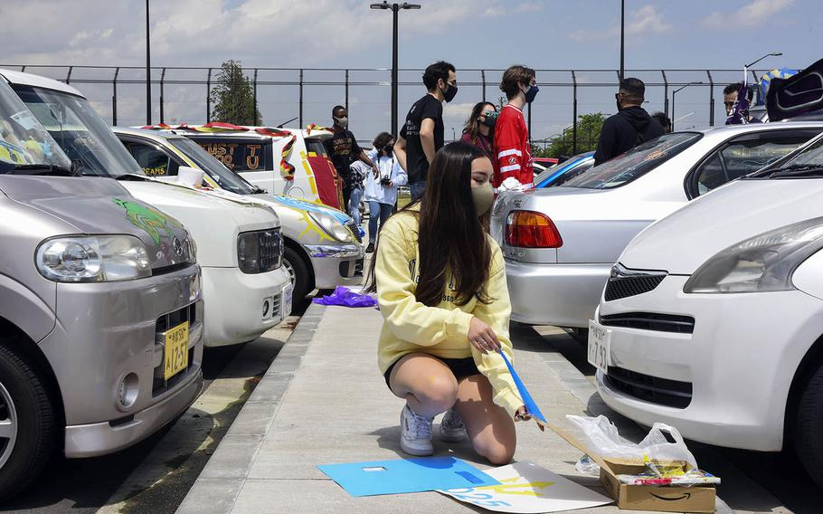 High school seniors decorate their cars to show off their post-graduation plans during a Decision Day parade at Yokota Air Base, Japan, Friday, April 30, 2021.