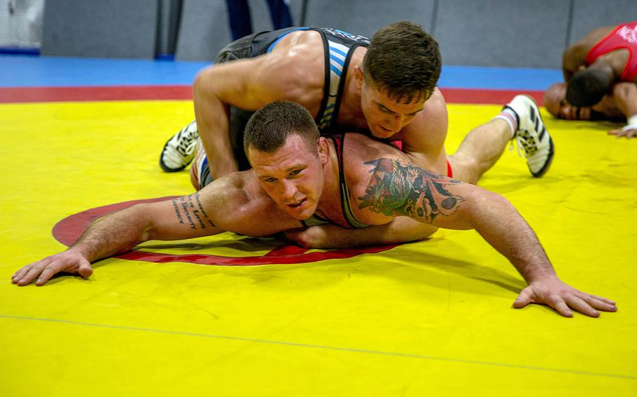 U.S. Marine Corps Staff Sgt. John Stefanowicz, bottom, and Capt. Peyton Walsh prepare for the Olympic Trials at Marine Corps Air Station New River, N.C., Jan. 8, 2021.
