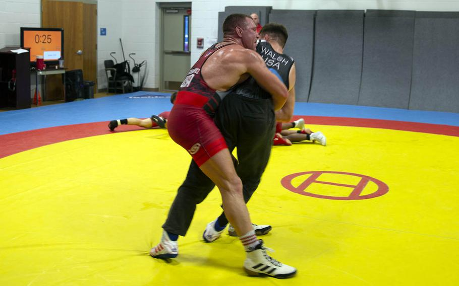U.S. Marine Corps Staff Sgt. John Stefanowicz, left, and Capt. Peyton Walsh prepare for the Olympic Trials at Marine Corps Air Station New River, N.C., Jan. 8, 2021.