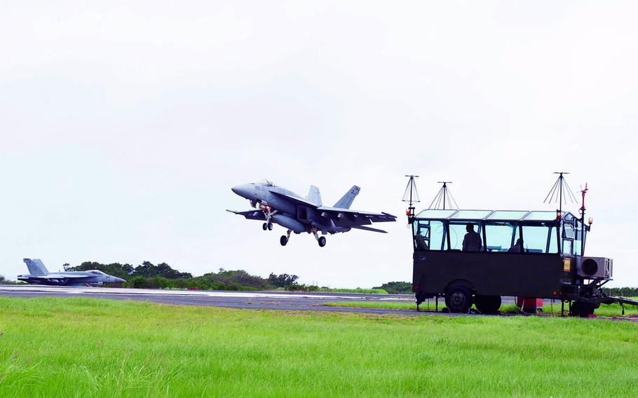 F/A-18s from Carrier Air Wing 5 at Marine Corps Air Station Iwakuni, Japan, take part in field carrier-landing practice on Iwo Jima in 2019.