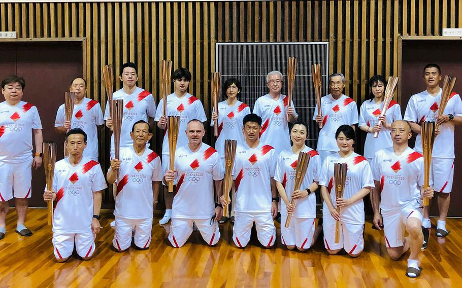 Capt. Brad Stalling, the chief of staff for U.S. Naval Forces Japan, was one of 16 people to carry the Olympic flame through Sasebo, Japan, Saturday, May 8, 2021.
