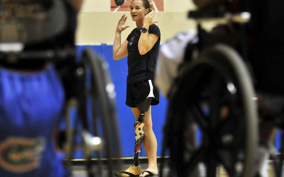 Former Army soldier Melissa Stockwell speaks to her injured service members at San Diego's Balboa Naval Medical Center in 2010.