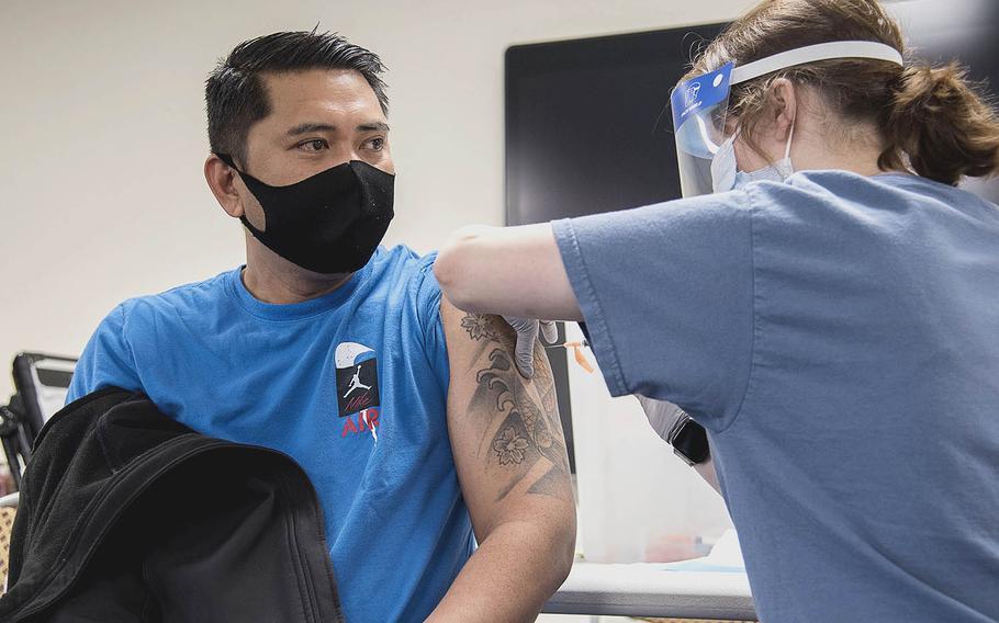 Petty Officer 1st Class Antonio Ledesma receives the Moderna coronavirus vaccine at  Naval Air Facility Atsugi, Japan, May 7, 2021.