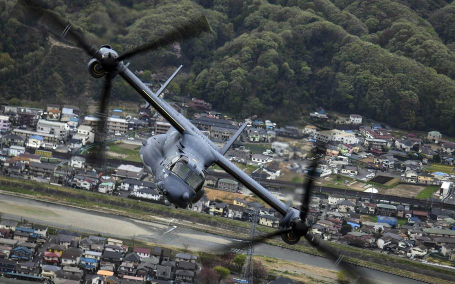 An Air Force CV-22 Osprey tiltrotor aircraft assigned to the 353rd Special Operations Group flies over Tokyo, April 5, 2018.