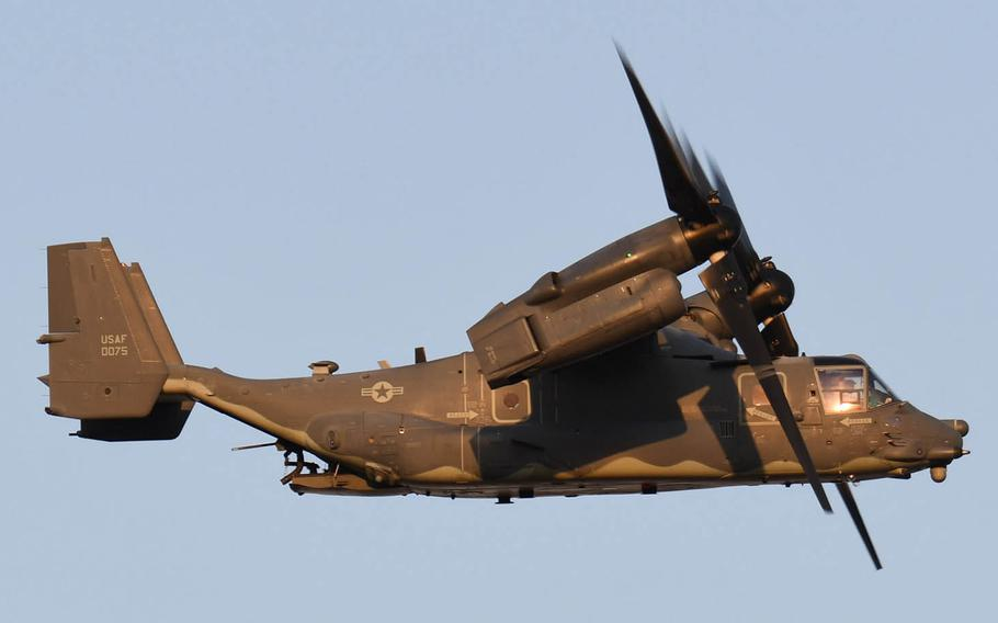 An anti-base group near Yokota Air Base in western Tokyo is complaining that CV-22 Ospreys have been flying over residential areas with their machine guns visible. The Air Force says the guns are only loaded for use over approved training areas.