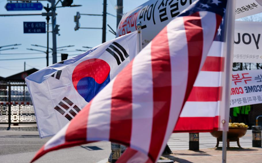 U.S. and South Korea flags are displayed together outside Camp Humphreys, South Korea, Monday, March 16, 2020.