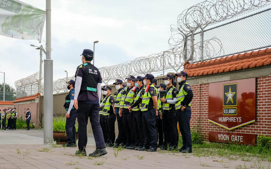 South Korean police stand guard during a protest outside Camp Humphreys, South Korea, Friday, Aug. 14, 2020.