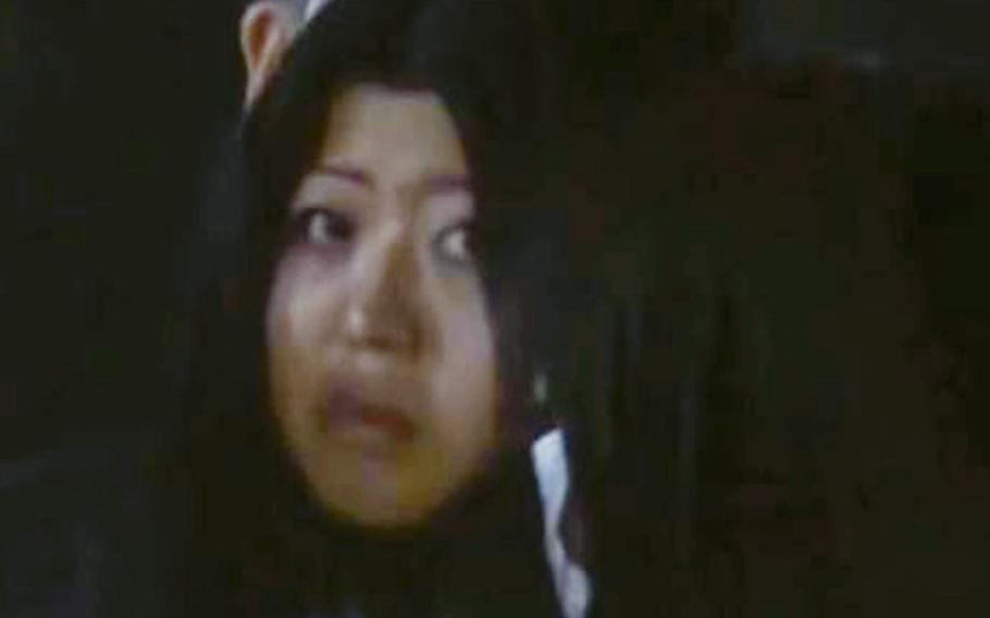 This screenshot from Japan's ANN News shows Aria Saito after being arrested at the scene of a fatal stabbing of an airman near Yokota Air Base, Japan, Friday, Nov. 9, 2018.