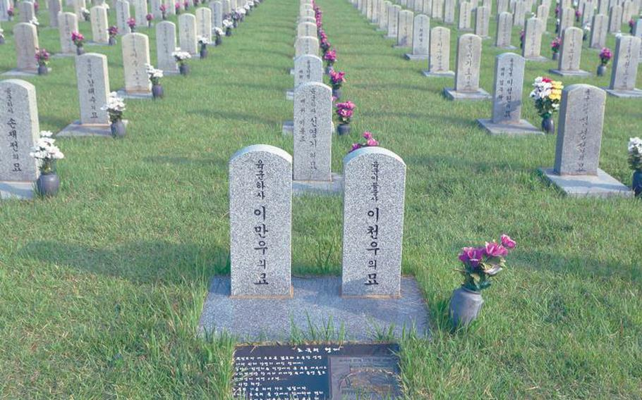The graves of two South Korean brothers who died while fighting in the Korean War are pictured in 206 at the National Cemetery in Seoul.