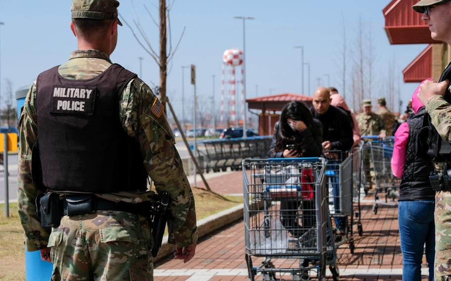 Customers wait to enter the commissary at Camp Humphreys, South Korea, Friday, March 27, 2020. Escalated health protection measures put limits on the number of people who can be inside the store at one time.