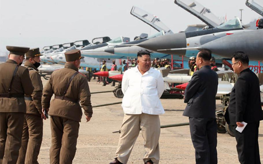 North Korean leader Kim Jong Un inspects fighter jets in a western area as shown in photos released Sunday, April 12, 2020, by the state-run Korean Central News Agency.