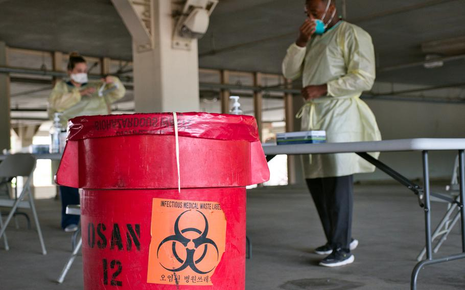 Service members from the 51st Medical Operations Squadron prepare to administer coronavirus tests at Osan Air Base, South Korea, July 14, 2020.