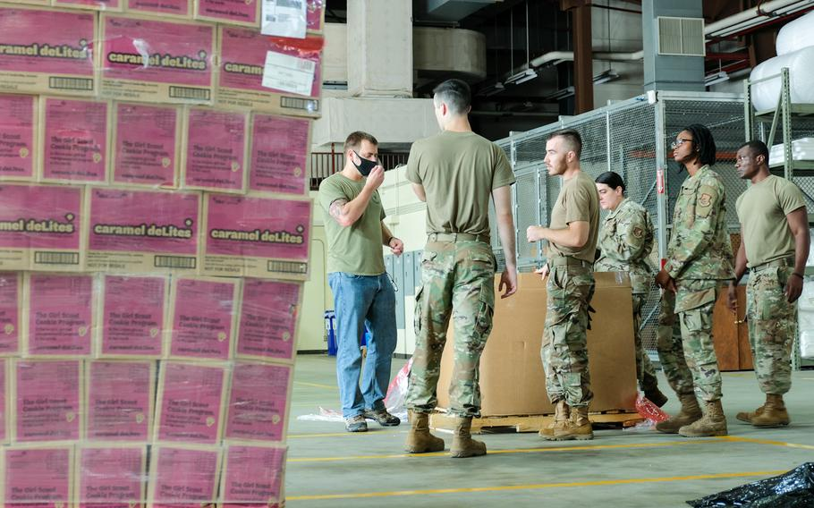 Members of the 51st Logistics Readiness Squadron at Osan Air Base, South Korea, prepare to organize donations for care packages that will go to service members quarantined in South Korea, Aug. 21, 2020.