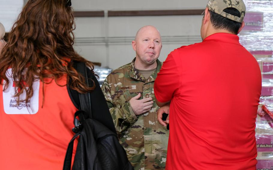 Chief Master Sgt. Brandon Dunston, a superintendent with the 7th Air Force, speaks with members of the American Red Cross at Osan Air Base, South Korea, Aug. 21, 2020.