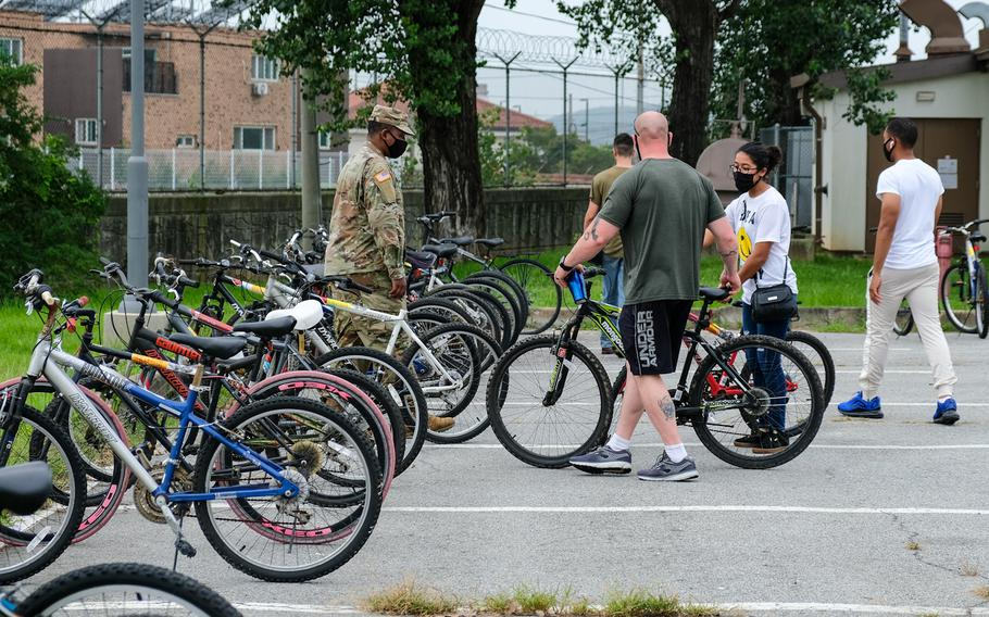 About 300 people waited their turn on Saturday, Aug. 22, 2020, to pick from nearly 250 bicycles abandoned at Camp Humphreys, South Korea.