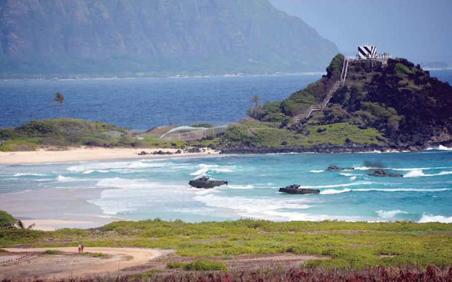 Amphibious-assault craft approach Pyramid Rock Beach at Marine Corps Base Hawaii during a Rim of the Pacific drill on July 29, 2018.
