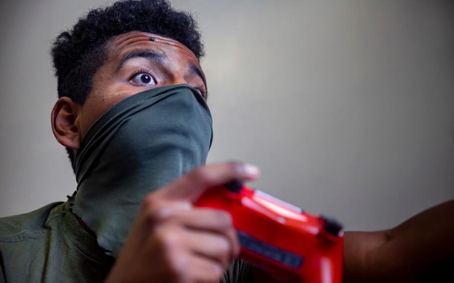 A newly arrived Marine, Pfc. Jonathan Pimentel Garcia of the 7th Communication Battalion, enjoys a video game while on his 14-day restriction of movement at Camp Foster, Okinawa, July 9, 2020.