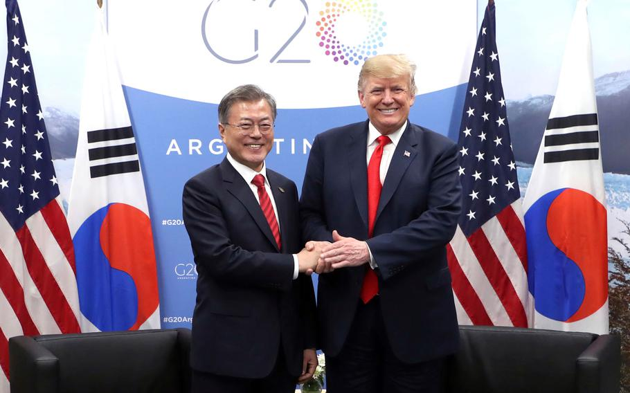 South Korean President Moon Jae-in, left, shakes hands with U.S. President Donald Trump during a meeting on the sidelines of the Group of 20 Leaders' Summit in Buenos Aires, Argentina, Nov. 30, 2018.