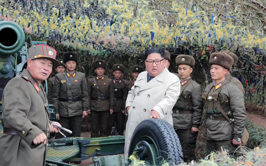 North Korean leader Kim Jong Un, center in white coat in an undated photo released Nov. 25, 2019, met with soldiers during a visit to Changrin islet near the disputed sea border off the Korean peninsula's west coast.