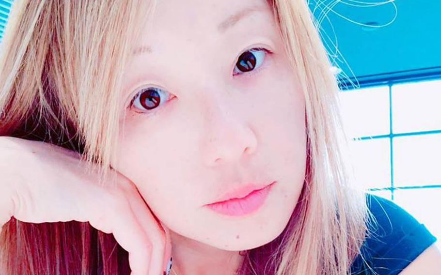 An autopsy showed that Tamae Hindman, 44, had defensive wounds on her hands, according to Okinawa Prefecture Police.