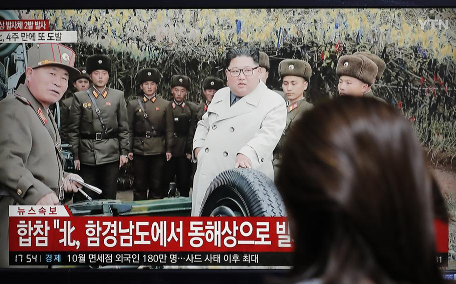 A woman watches a news program reporting North Korea's firing unidentified projectiles with a file image of North Korean leader Kim Jong Un, in Seoul, South Korea, Thursday, Nov. 28, 2019.