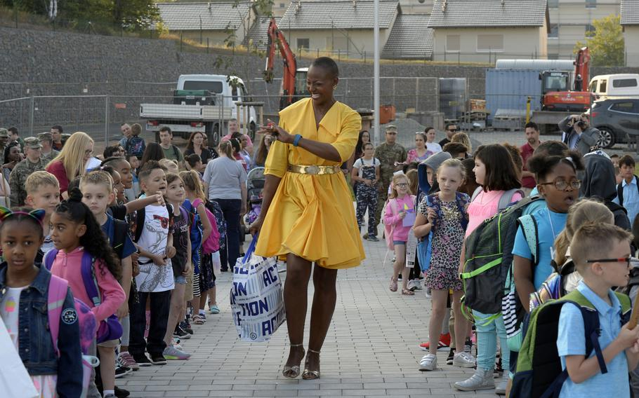 Teacher Watoma Taylor greets students on the first day of school at the new Vogelweh Elementary School, Monday, Aug. 26, 2019.