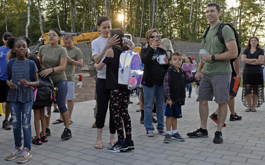 Parents wish their children a good day as they arrive for the first day of school at the new Vogelweh Elementary School, Monday, Aug. 26, 2019.