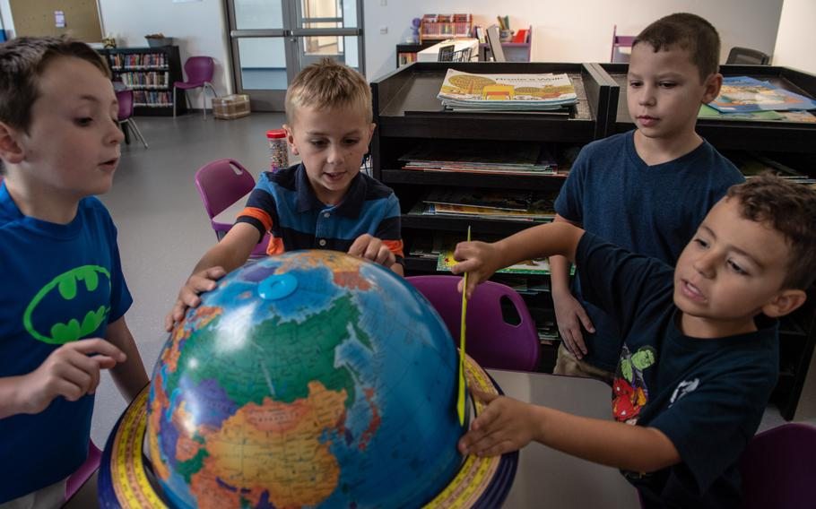 Students discover the globe in the library during second-grade orientation at the new Vogelweh Elementary School, Saturday, Aug. 24, 2019.