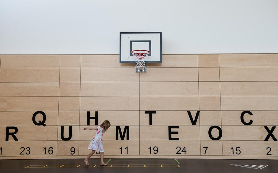 Evelyn Koch plays in the gym at the new Vogelweh Elementary School, Saturday, Aug. 24, 2019.