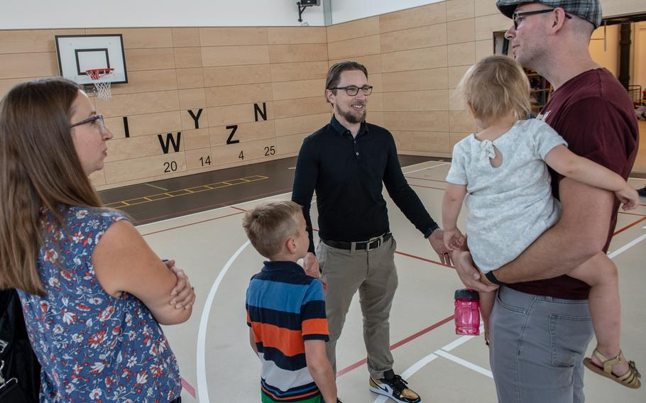 Principal David Lee talks with the Koch family during second grade orientation at the new Vogelweh Elementary School, Saturday, Aug. 24, 2019.