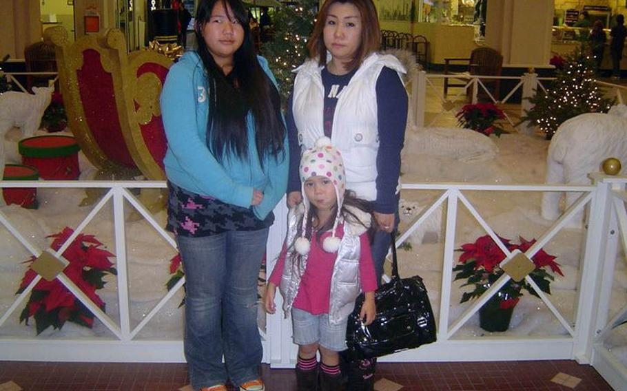 Yumiko Conway, right, and her daughter, Christina, pose in this undated photo. Conway is believed to have brought her daughter from California to Japan in 2012 during divorce proceedings, without the consent of the father, former sailor Donny Conway. The father has not seen or heard from them since.