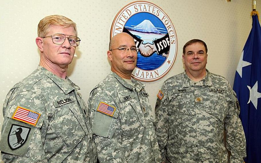 Lt. Col. Lou Nelson, left, Maj. Jim Hewitt, center, and Maj. Mike McGurl are all retirees who have recently returned to active duty with the U.S. Army and are now assigned to U.S. Forces Japan at Yokota.