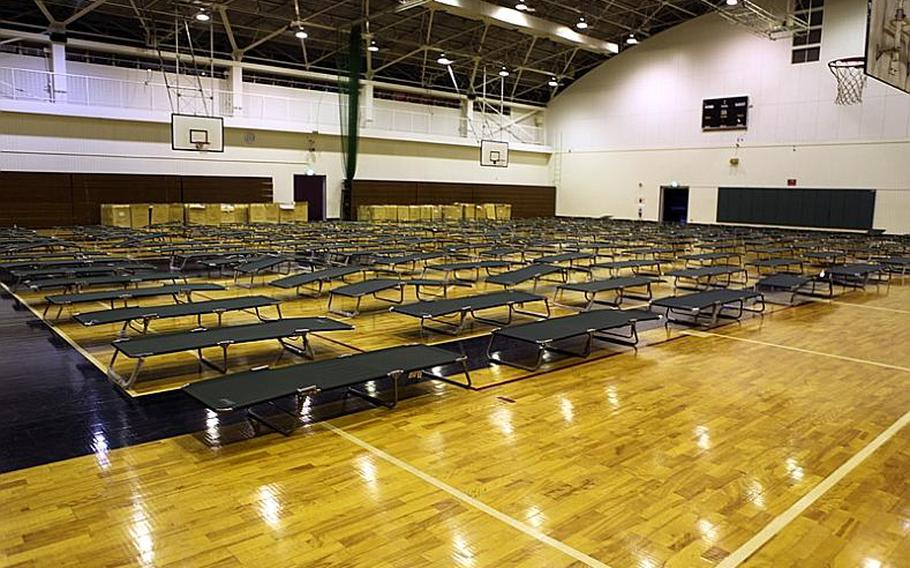 About 400 cots were set up at the Samurai Fitness Center at Yokota Air Base as part of the base's contingency preparations after heavy rain Monday night led to flooding and evacuation of some base residents from their homes.