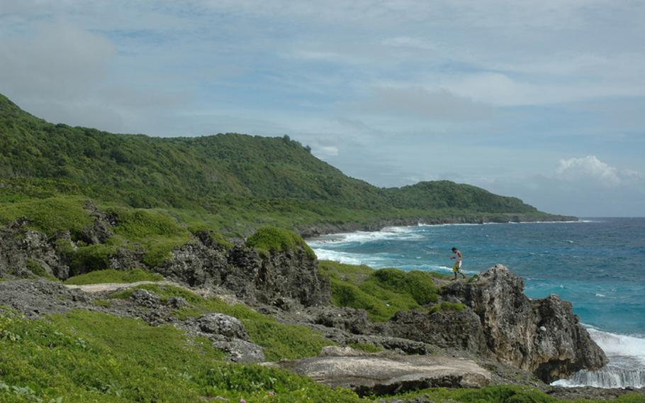 A man walks along Guam's eastern shore in an area near Pagat, the site of an ancient Chamorro village, in the summer of 2010. The military has proposed putting a firing range adjacent to the village on land stretching further north up the coast. That proposal, despite offers to keep the Pagat area accessible to the public, has not appeased some. Earlier that year, the National Trust for Historic Preservation put the area on its most endangered list.