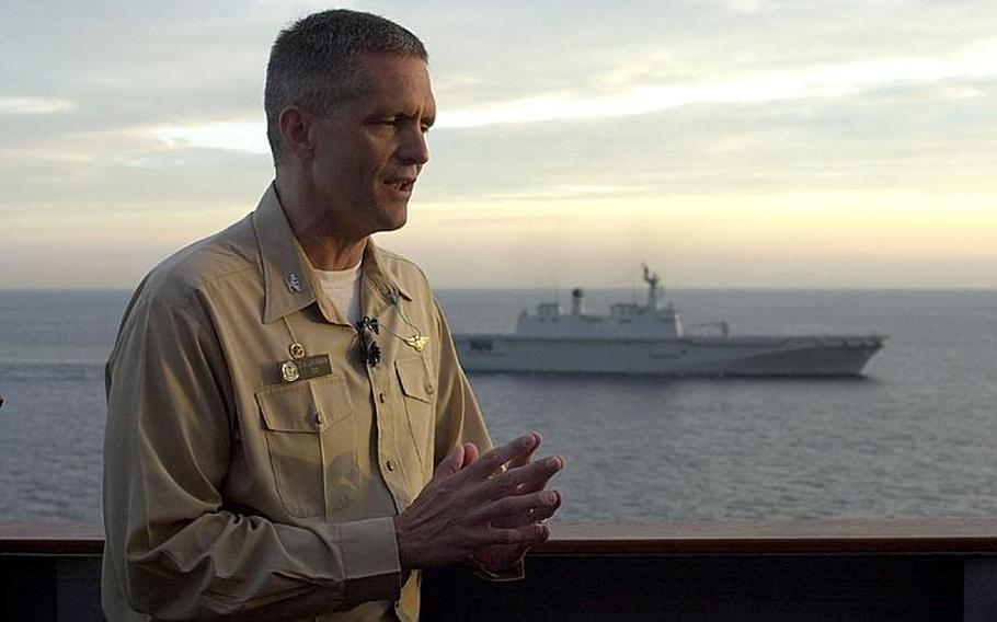 Capt. David A. Lausman, commander of the USS George Washington, talks Monday with the media on the second day of the joint U.S.-South Korean Invincible Spirit military exercise off the east coast of South Korea.