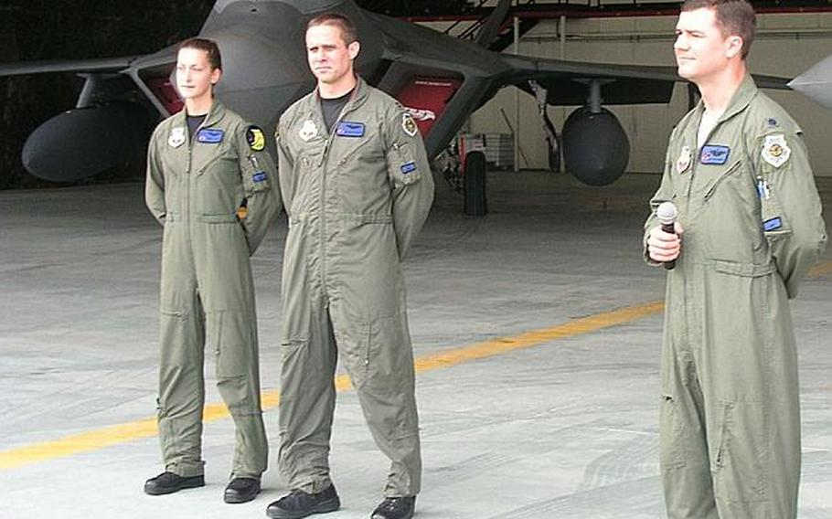 At Osan Air Base in South Korea on Monday, three Air Force pilots who fly the advanced F-22 Raptor fighter answer reporters' questions about the aircraft, two of which are parked behind them. The  Raptors will take part in this week's large-scale, naval air exercise that runs Sunday through Wednesday. From left are Maj. Jammie Jamieson, Capt. Brandon Tellez and Lt. Col. Robert Teschner. All are with the 7th Expeditionary Fighter Squadron, of which Teschner is commander.