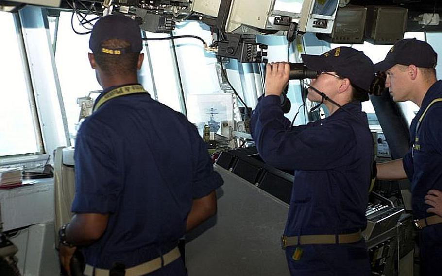 Crewmembers aboard the guided-missile destroyer USS Curtis Wilbur, based out of Yokosuka Naval Base, Japan, scan the horizon Tuesday during the Invincible Spirit military exercise the U.S. and South Korea have been staging off the east coast of the Korean peninsula. The exercise was scheduled to conclude Wednesday.