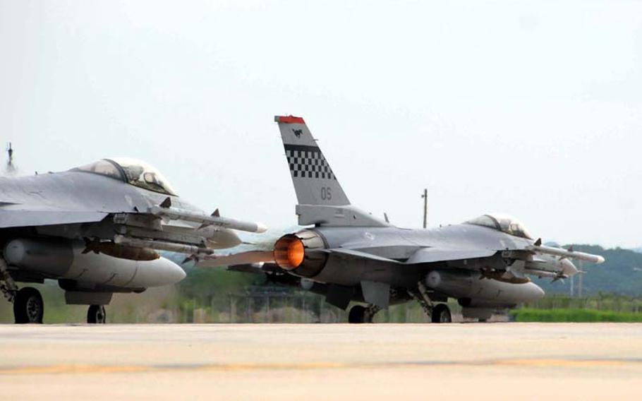 Two F-16C fighter jets take off on a combat training mission Wednesday at Osan Air Base, South Korea. Flying the mission as part of the Invincible Spirit exercise were Capt. Christopher Moeller and Capt. David Bennett, both of the 36th Fighter Squadron, part of Osan?s 51st Fighter Wing. The exercise concluded Wednesday night.