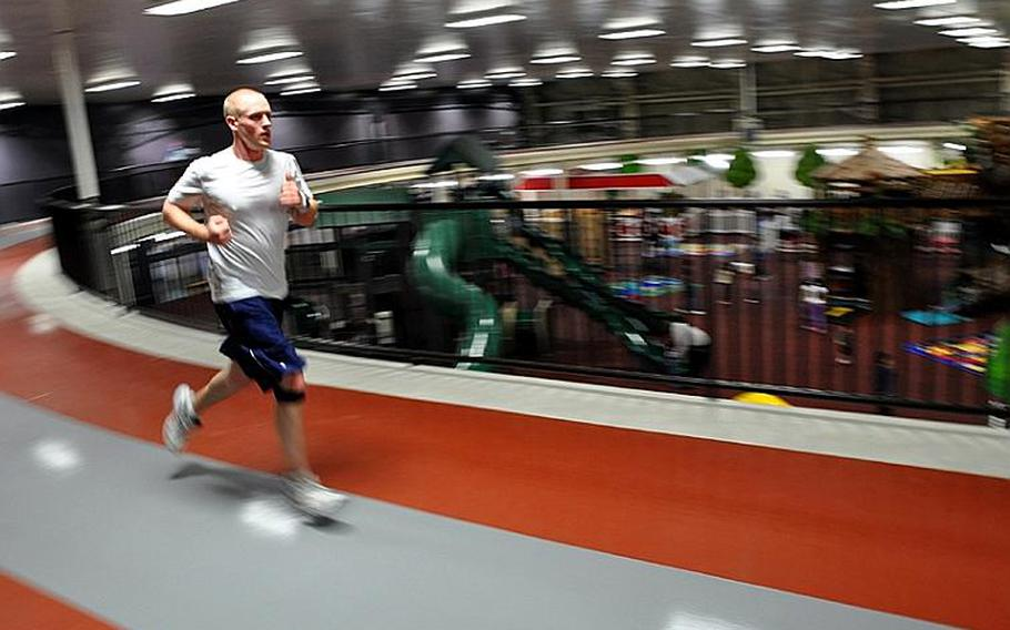 Seaman Apprentice Zachary James works out on the new indoor, elevated running track at Misawa Air Base, Japan, on Saturday. Officials unveiled the track to the community during a grand opening ceremony earlier in the day.