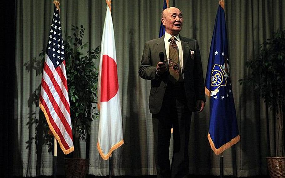 Hamaki Tanaka,the attorney adviser for the Office of the Staff Judge Advocate 5th Air Force, says his farewells after 59 years of service to the U.S. government during his retirement ceremony Friday.