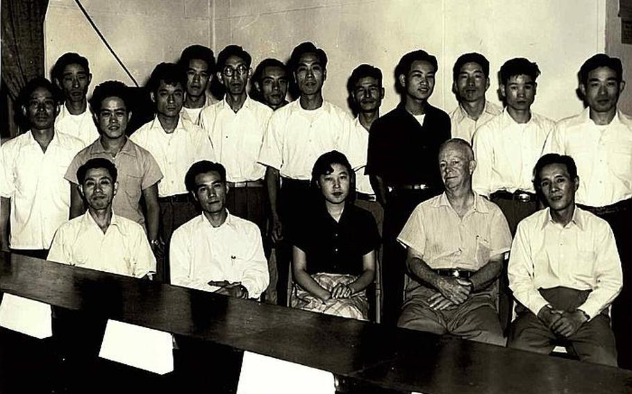Hamaki Tanaka, front row, second from the left, is pictured during his time working at the Civilian Personnel Office at Yokota Air Base, Japan. Tanaka is retiring as the attorney adviser for the Office of the Staff Judge Advocate 5th Air Force after 59 years of service to the U.S. government.