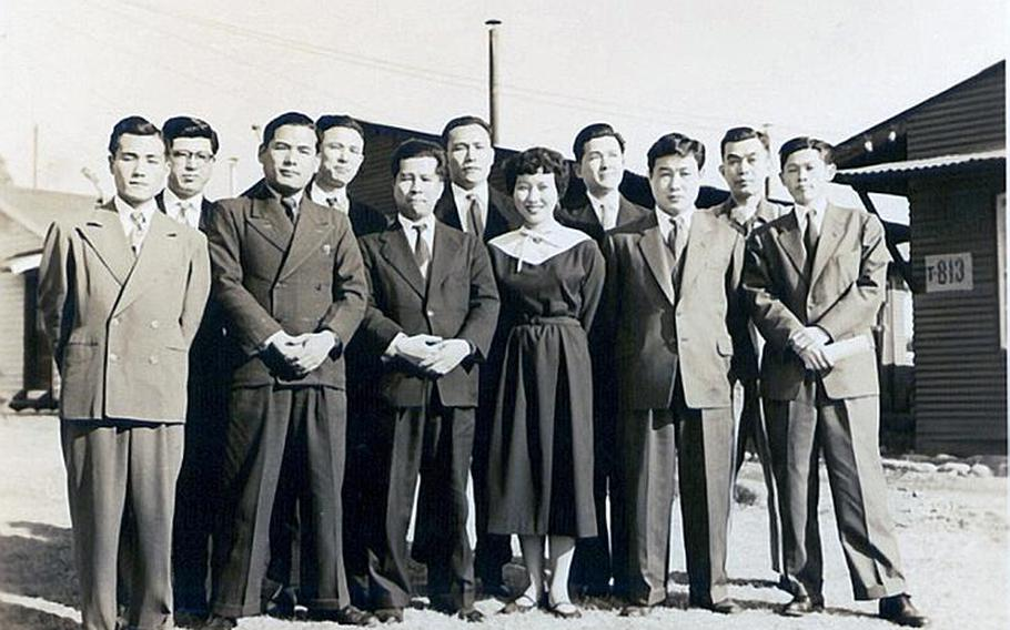 Hamaki Tanaka, far left in front row, is pictured here at the Central Civilian Personnel Office at Yokota Air Base, Japan, in 1957. Tanaka is retiring as the attorney adviser for the Office of the Staff Judge Advocate 5th Air Force after 59 years of service to the U.S. government.