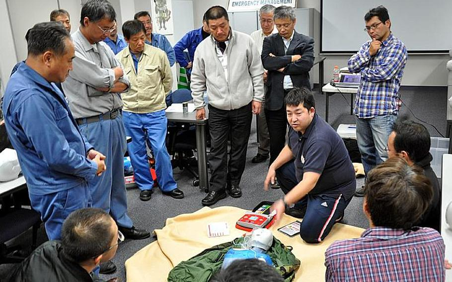 Yasuyuki Yoshikawa, with the Amori Chapter of the Japanese Red Cross Society, gives a training class Tuesday to Japanese employees who work for the U.S. Air Force's 35th Civil Engineer Squadron at Misawa Air Base, Japan.