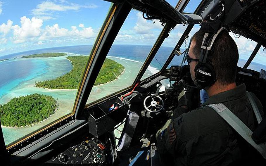Capt. Phillip Newman, a C-130 Hercules pilot with 36th Airlift Squadron takes in the beauty of the Yap Islands during a flight for Operation Christmas Drop on Tuesday.