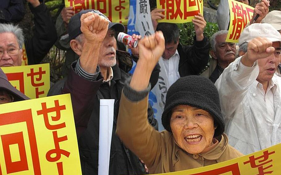 Toshiko Isagawa, 70, of Ginowan was among the protesters who gathered Friday in front of the Okinawa prefectural government office to protest Prime Minister Naoto Kan's visit to the island.
