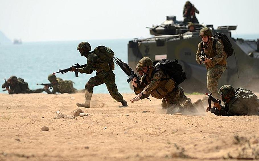 Royal Thai Marines, along with infantry Marines with the Battalion Landing Team, 2nd Battalion, 5th Marine Regiment, 31st Marine Expeditionary Unit, 3rd Marine Expeditionary Brigade Forward (FWD) assault the beachhead in Hat Yao, Thailand, in a mock amphibious assault raid Thursday during Exercise Cobra Gold 2011.