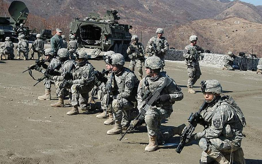 Soldiers line up after exiting four Strykers brought to South Korea for the annual Foal Eagle/Key Resolve live-fire drills near the Demilitarized Zone in March of 2011.
