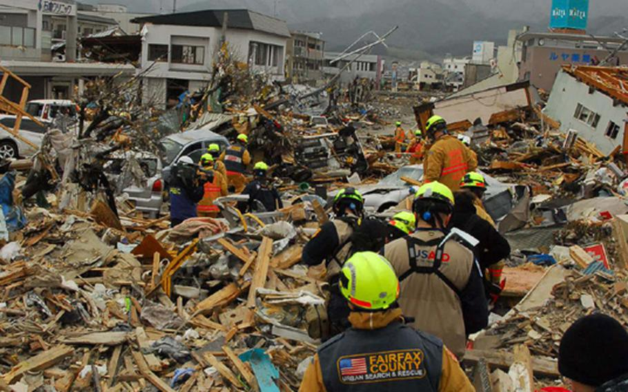 A Fairfax County search-and-rescue unit walks into the disaster zone at Ofunato, Japan, as it begins rescue efforts Tuesday.